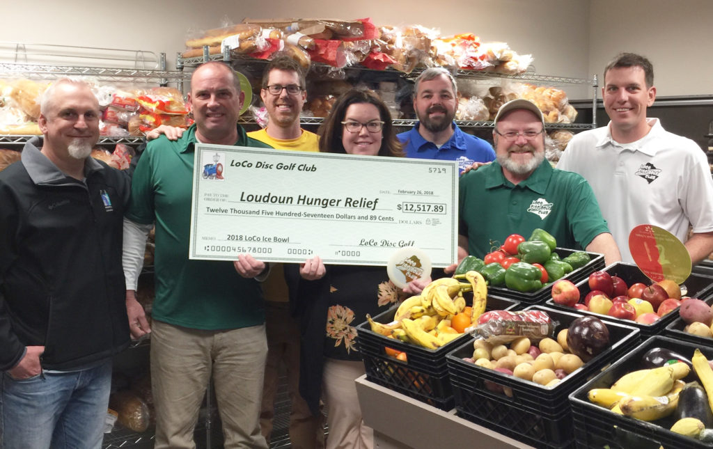 LoCo Disc Golf presents $12,517.89 check to Loudoun Hunger Relief.